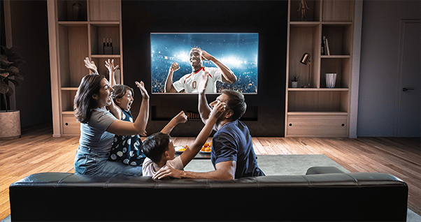 Family watching wall mounted TV