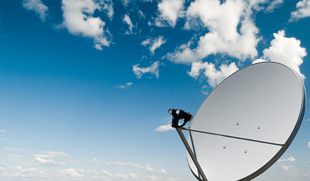 Satelite Dish with blue sky and clouds