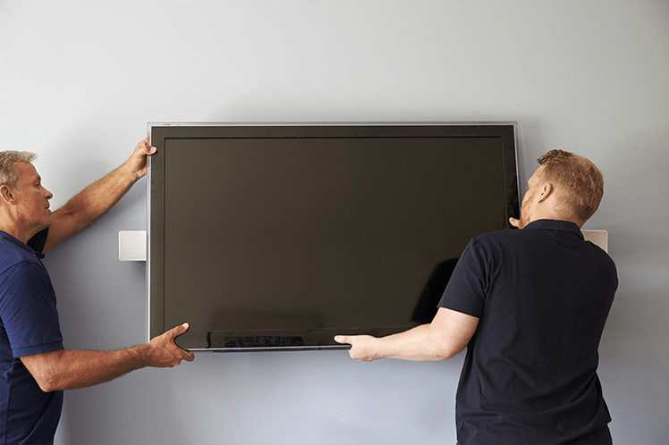 2 men installing wall mounted TV in Romford