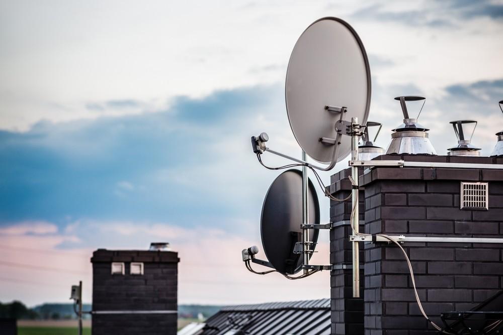 Satelite dishes on chimney in Romford