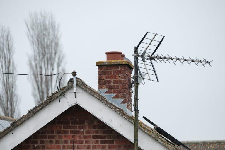 TV aerial on Brentwood roof top with chimney