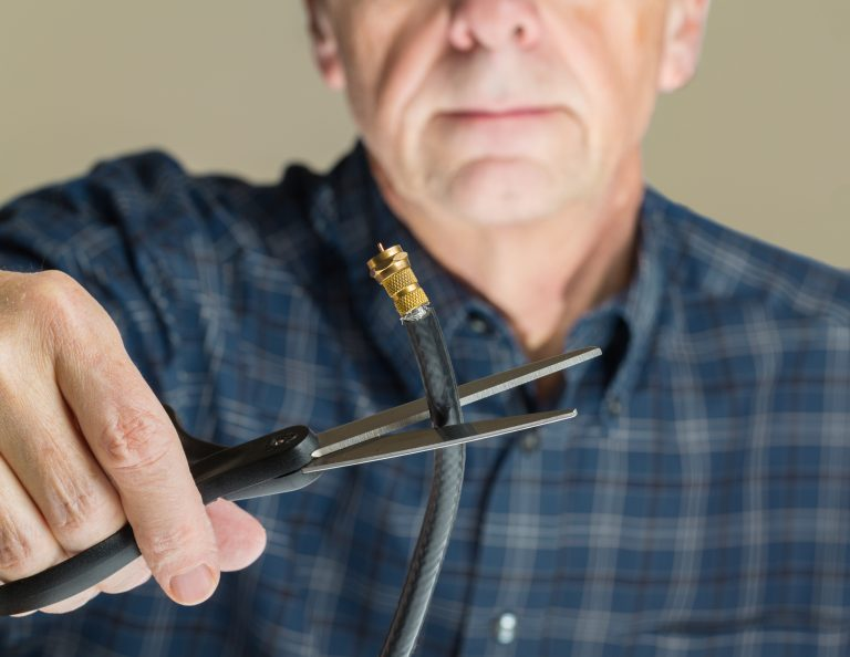 man cutting aerial cable