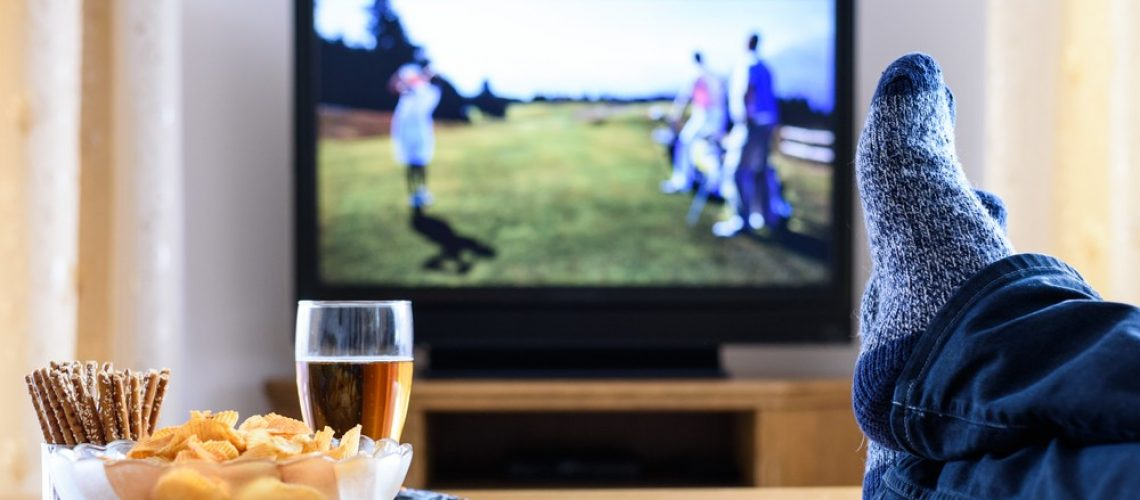 television,,tv,watching,(golf,game),in,living,room,with,feet