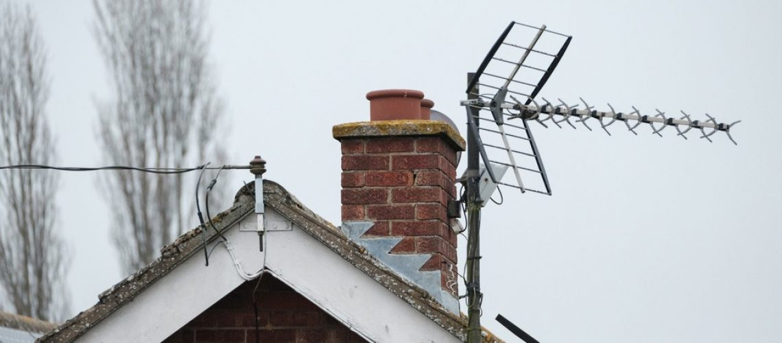 TV aerial on romford roof top with chimney